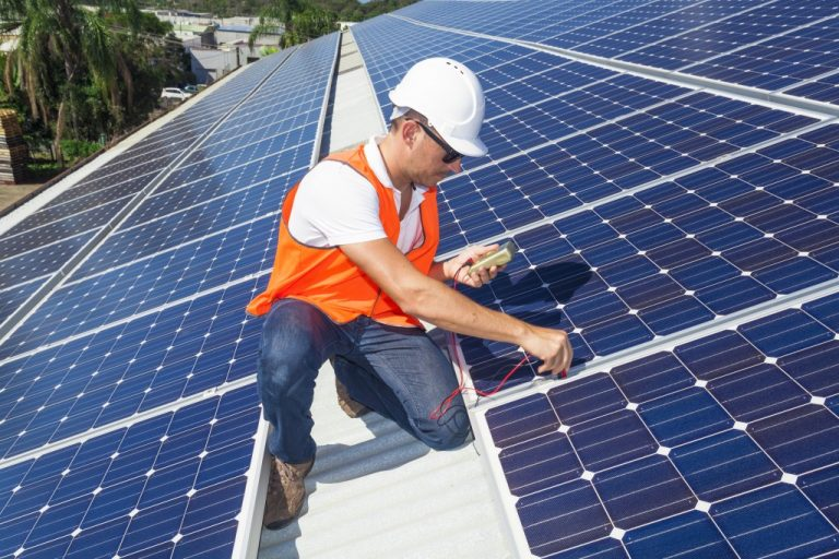 Man checking solar panels