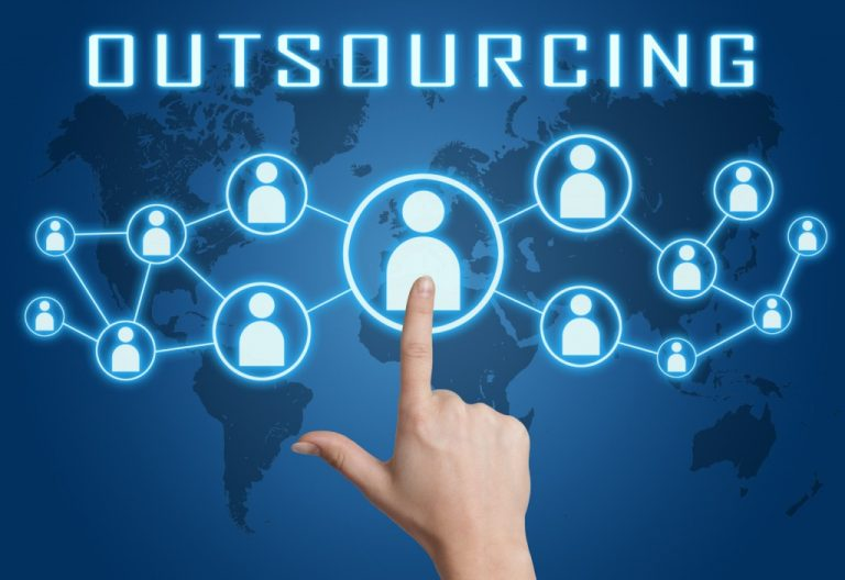 Outsourcing concept with hand pressing social icons on blue world map background.