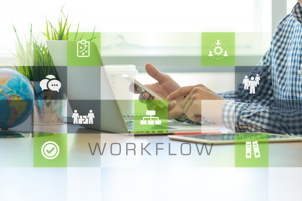 Businessman working in office and Workflow icons concept