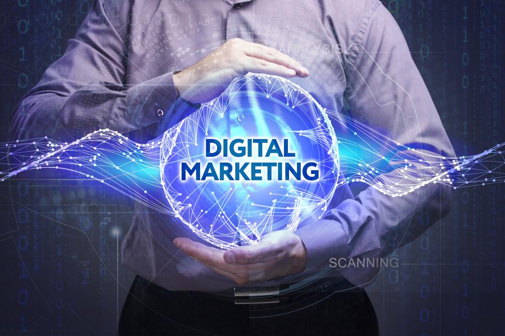 man holding digital marketing globe