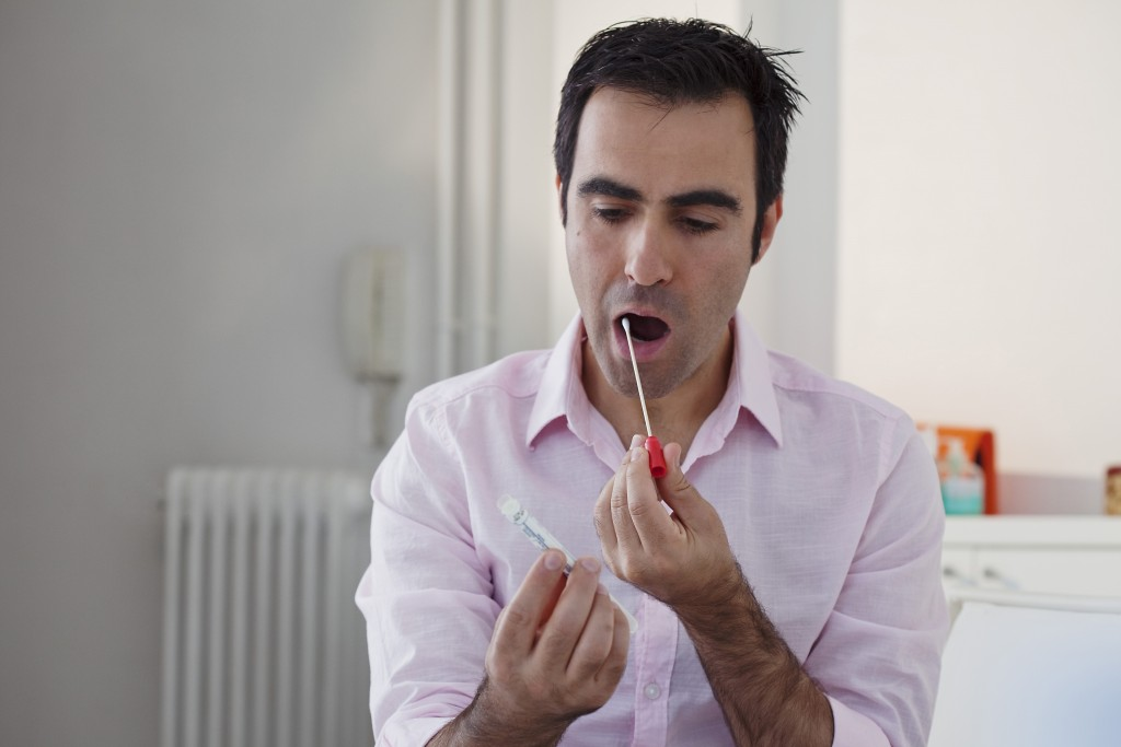 man taking a swab test
